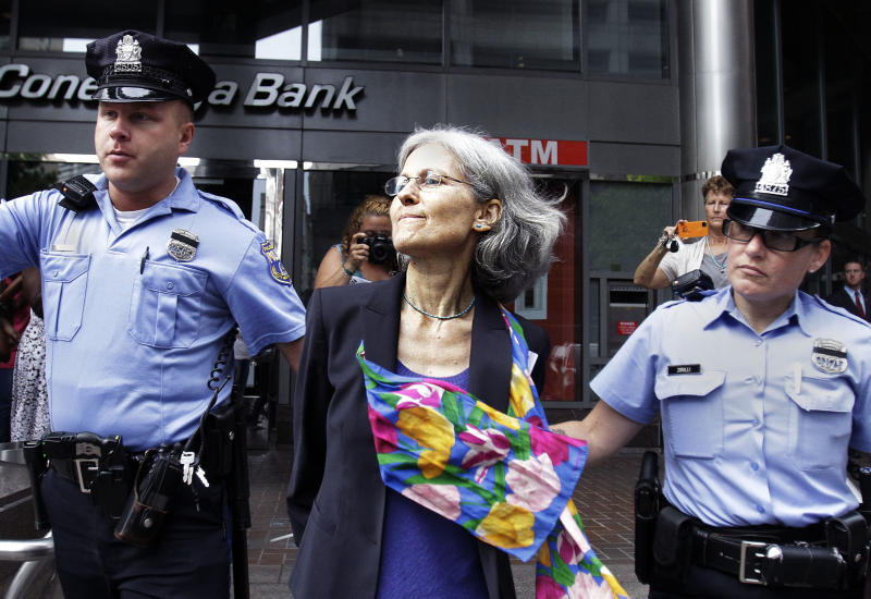 Green Party presidential nominee Jill Stein, is transported in restraints to be arrested after a sit-in at a downtown Philadelphia bank over housing foreclosures. Wednesday, Aug. 1, 2012, in Philadelphia.  About 50 Green Party supporters hope to protest at Fannie Mae. (AP Photo/Brynn Anderson)