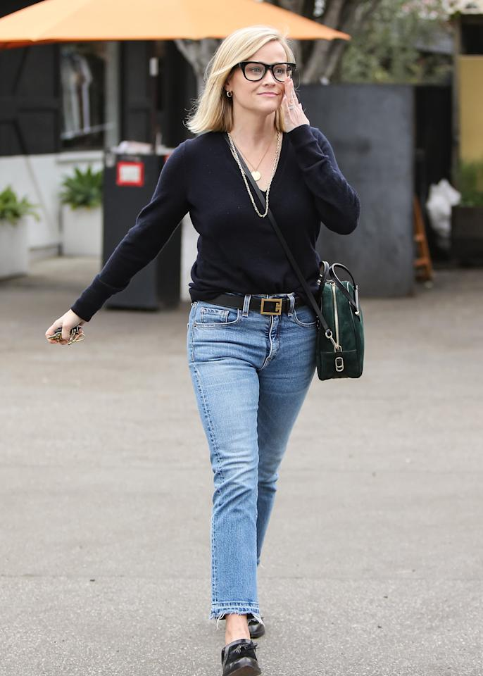 <p>She elevates her casual look with a pair of reading glasses, a crossbody bag, and gold chain necklaces.</p>