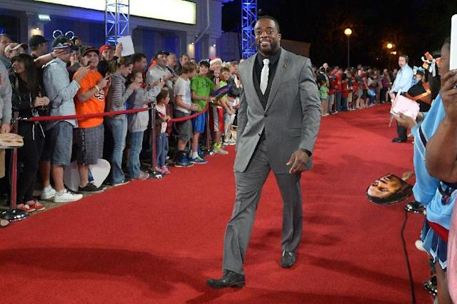 Boston College running back Andre Williams walks down the red carpet after arriving for the College Football Awards show in Lake Buena Vista, Fla., Thursday, Dec. 12, 2013.(AP Photo/Phelan M. Ebenhack)