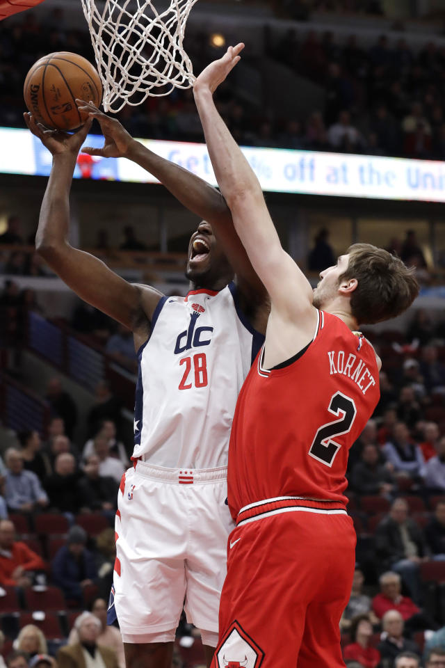 Washington Wizards center Ian Mahinmi, left, shoots next to Chicago Bulls forward Luke Kornet during the first half of an NBA basketball game in Chicago, Wednesday, Jan. 15, 2020. (AP Photo/Nam Y. Huh)