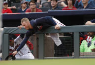 Atlanta Braves starting pitcher Mike Foltynewicz reaches over the dugout railing for a foul ball in the first inning of a baseball game against the New York Mets Tuesday, June 18, 2019, in Atlanta. Foltynewicz was not in the starting lineup. (AP Photo/John Bazemore)