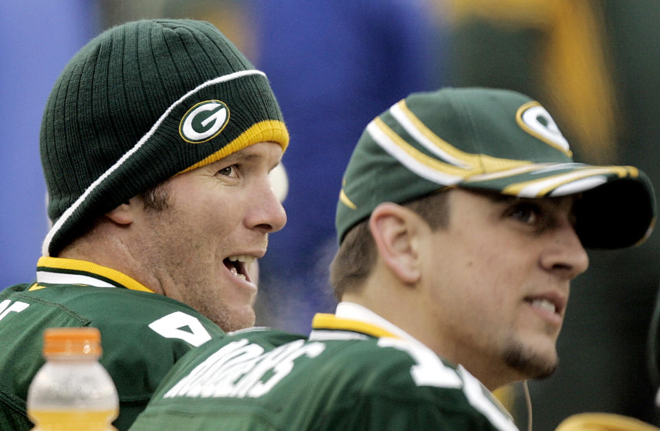 FILE - In this Jan. 1, 2006, file photo, Green Bay Packers quarterback Brett Favre, left, and back-up Aaron Rogers share time on the bench during their NFL football game against the Seattle Seahawks in Green Bay, Wis. Former quarterback Favre says Rodgers was surprised by Green Bay's decision to draft a quarterback in the first round. Favre said Wednesday, April 29, 2020, on