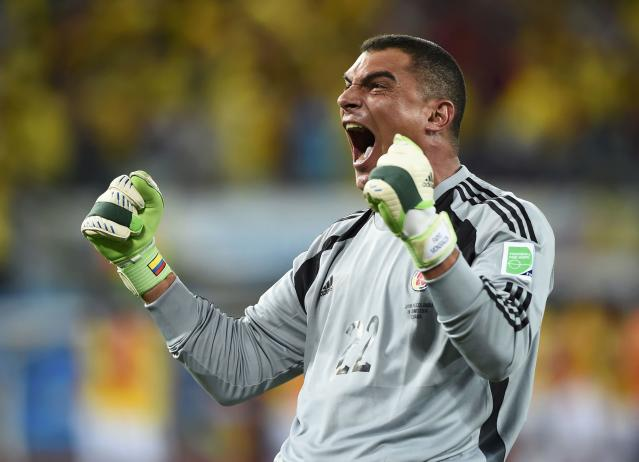 Colombia's goalkeeper Faryd Mondragon celebrates his team's fourth goal against Japan during their 2014 World Cup Group C soccer match at the Pantanal arena in Cuiaba June 24, 2014. REUTERS/Dylan Martinez (BRAZIL - Tags: SOCCER SPORT WORLD CUP) TOPCUP