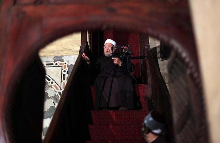 FILE -- In this Friday, Dec. 28, 2012 file photo, Shiekh Youssef al-Qaradawi, gives the sermon during the Friday prayer at Al-Azhar mosque in Cairo, Egypt. Syria's civil war has morphed into a proxy fight in which Shiite Iran has strongly backed Assad, while Sunni Arab nations have backed rebels. Many Sunni hard-liners around the Mideast have taken Hezbollah's intervention in Syria almost as a declaration of war by Shiites against Sunnis. (AP Photo/Khalil Hamra, File)