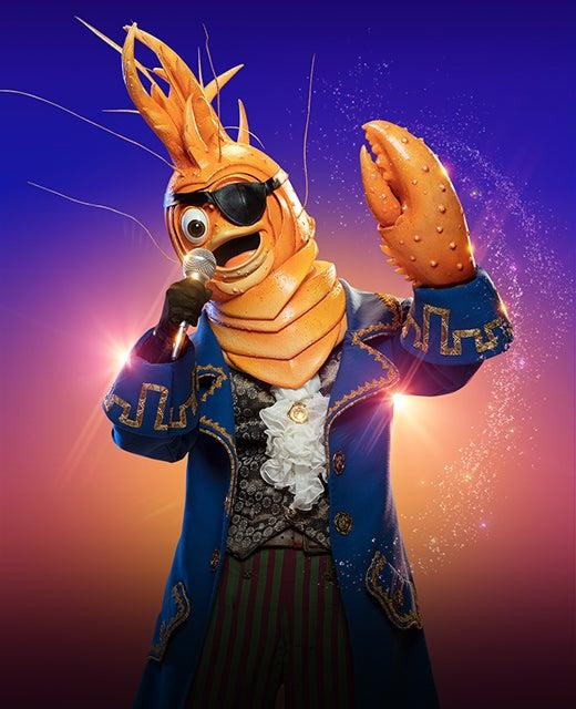The Prawn from the Masked Signer belts out a song while wearing a pirate outfit in a promo picture for the show.