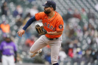 Houston Astros starting pitcher Jose Urquidy works against the Colorado Rockies in the third inning of a baseball game Wednesday, April 21, 2021, in Denver. (AP Photo/David Zalubowski)