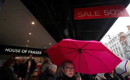 FILE PHOTO: Shoppers walk past House of Fraser on Oxford Street in central London, Britain, April 2, 2018. REUTERS/Hannah McKay/File Photo