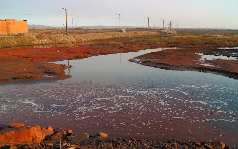 Some 20,000 tonnes of diesel fuel has been released into the local river, turning it crimson - Vasiliy Ryabinin via AP