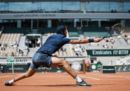 Russia's Karen Khachanov plays a return to Japan's Kei Nishikori during their second round match on day four of the French Open tennis tournament at Roland Garros in Paris, France, Wednesday, June 2, 2021. (AP Photo/Thibault Camus)