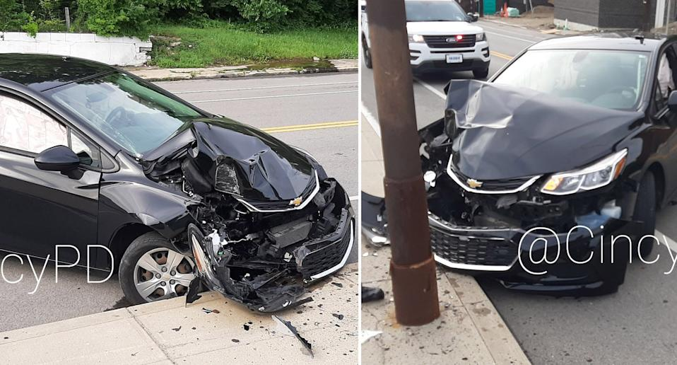 A Chevrolet pictured crashed into a power pole.