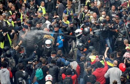 FILE PHOTO: French police apprehend protesters during the May Day march involving French unions and yellow vest protesters in Paris