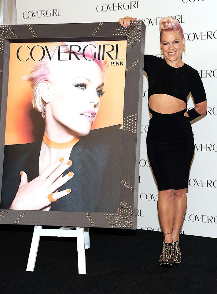"Always a risk-taker, Pink showed off quite a bit of skin on Monday afternoon during a press conference where she was named <a target=""_blank"" href=""http://omg.yahoo.com/news/first-look-pink-newest-covergirl-180200339.html"">the newest face of Covergirl Cosmetics</a>. Wearing a daring, belly-baring Norma Kamali dress and studded Alexander McQueen ankle boots, the ""So What"" songstress -- who gave birth to daughter Willow Sage Hart last summer -- posed for photographers who were impressed with the new mom's fit physique. Prepare to see a lot more of Pink this year; the brash pop tart drops her sixth studio album, <i>The Truth About Love</i>, in September. (8/6/2012)"