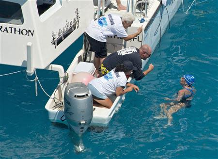Swimmer Diana Nyad converses with her crew less than two miles off Key West, Florida in this September 2, 2013 handout photo. REUTERS/Andy Newman/Florida Keys News Bureau/Handout via Reuters