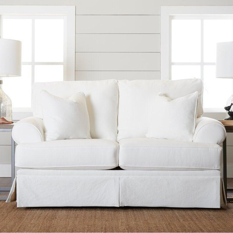 """<h2>29% Off Kelly Clarkson Home Negley Flared Arm Slipcovered Loveseat</h2><br><strong>19 reviews and 4.8 out of 5 stars</strong><br>""""Love it with the ottoman. Perfect size and I like that it is deep and oversized."""" <em>– Wayfair Reviewer</em><br><br><em>Shop <strong><a href=""""https://www.wayfair.com/furniture/pdp/kelly-clarkson-home-negley-68-flared-arm-slipcovered-loveseat-w002844900.html"""" rel=""""nofollow noopener"""" target=""""_blank"""" data-ylk=""""slk:Wayfair"""" class=""""link rapid-noclick-resp"""">Wayfair</a></strong></em><br><br><strong>Kelly Clarkson Home</strong> Negley 68"""" Flared Arm Slipcovered Loveseat, $, available at <a href=""""https://go.skimresources.com/?id=30283X879131&url=https%3A%2F%2Fwww.wayfair.com%2Ffurniture%2Fpdp%2Fkelly-clarkson-home-negley-68-flared-arm-slipcovered-loveseat-w002844900.html"""" rel=""""nofollow noopener"""" target=""""_blank"""" data-ylk=""""slk:Wayfair"""" class=""""link rapid-noclick-resp"""">Wayfair</a>"""