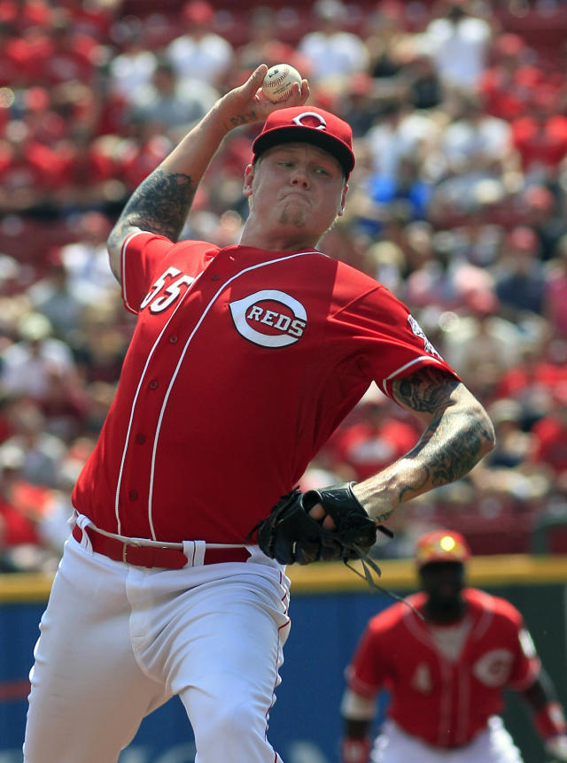 Cincinnati Reds' Matt Latos pitches against the St. Louis Cardinals in the first inning in their baseball game in Cincinnati, Monday Sept. 2, 2013. (AP Photo/Tom Uhlman)