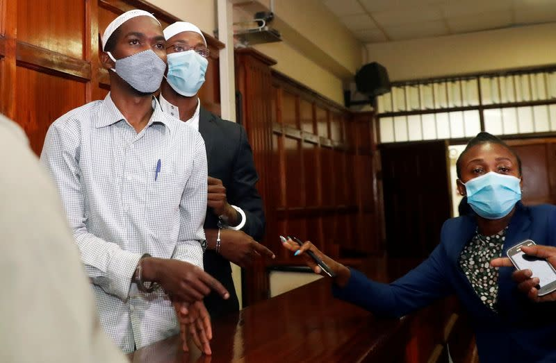 Hussein Hassan and Mohamed Ahmed, suspects charged with helping al Qaeda-linked militants to launch an attack on the Westgate mall, leave the dock before being sentenced, at the Milimani Law Courts in Nairobi