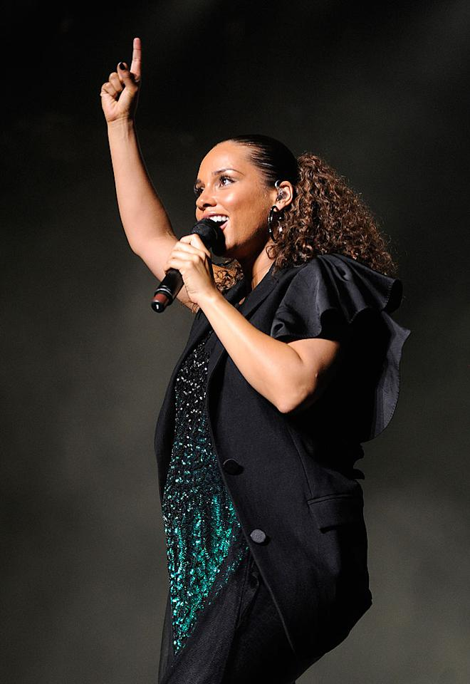 "On Saturday, it was Alicia Keys' turn to shine. The pregnant songstress got so into her set she took a tumble during ""Love is Blind."" Fortunately, she picked herself right back up! Frank Micelotta/<a href=""http://www.gettyimages.com/"" target=""new"">GettyImages.com</a> - July 3, 2010"
