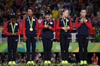 <p>(L to R) Gold Medalists Simone Biles, Gabrielle Douglas, Lauren Hernandez, Madison Kocian and Alexandra Raisman of the United States stand on the podium at the medal ceremony for the Artistic Gymnastics Women's Team on Day 4 of the Rio 2016 Olympic Games at the Rio Olympic Arena on August 9, 2016 in Rio de Janeiro, Brazil. (Photo by Laurence Griffiths/Getty Images) </p>