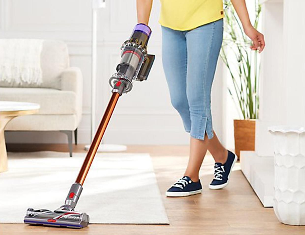 We're gonna level with you: The V11 effortlessly adapts from the shaggiest of rugs to the smoothest bare floors (Photo: QVC)