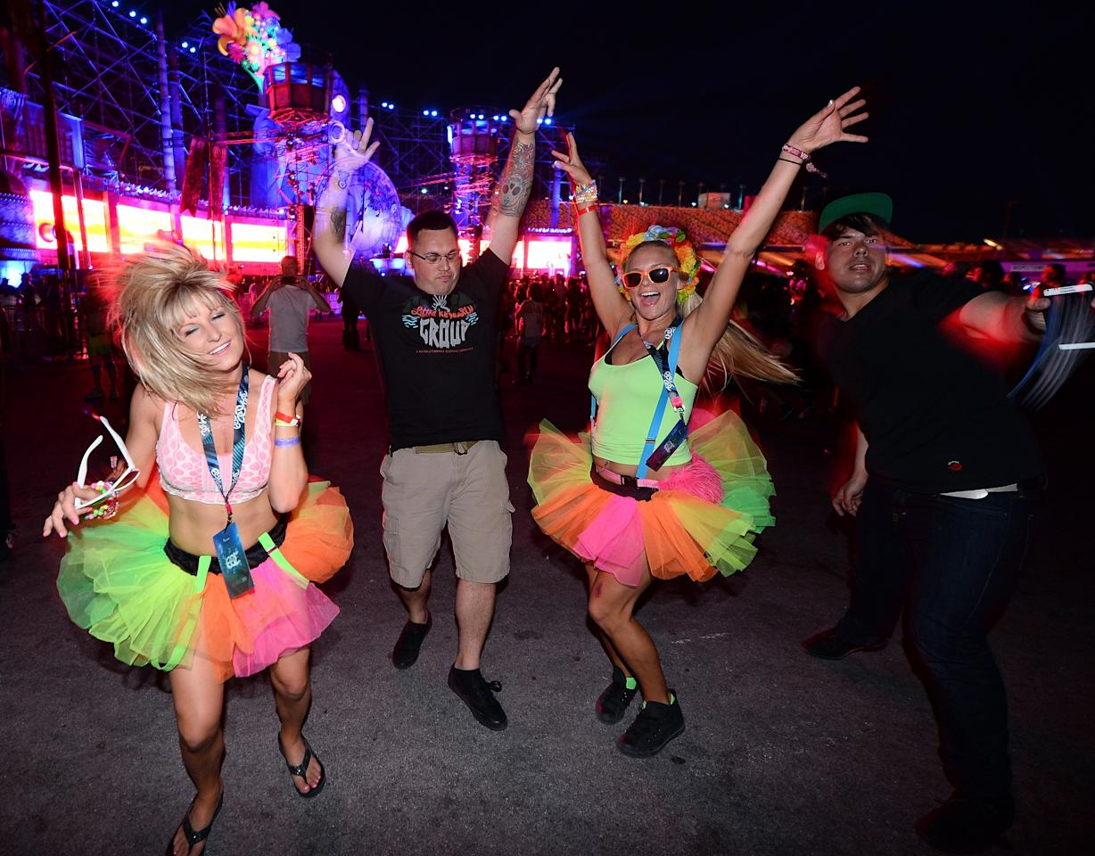 LAS VEGAS, NV - JUNE 22: Attendees dance at the 17th annual Electric Daisy Carnival at Las Vegas Motor Speedway on June 22, 2013 in Las Vegas, Nevada. (Photo by Ethan Miller/Getty Images)