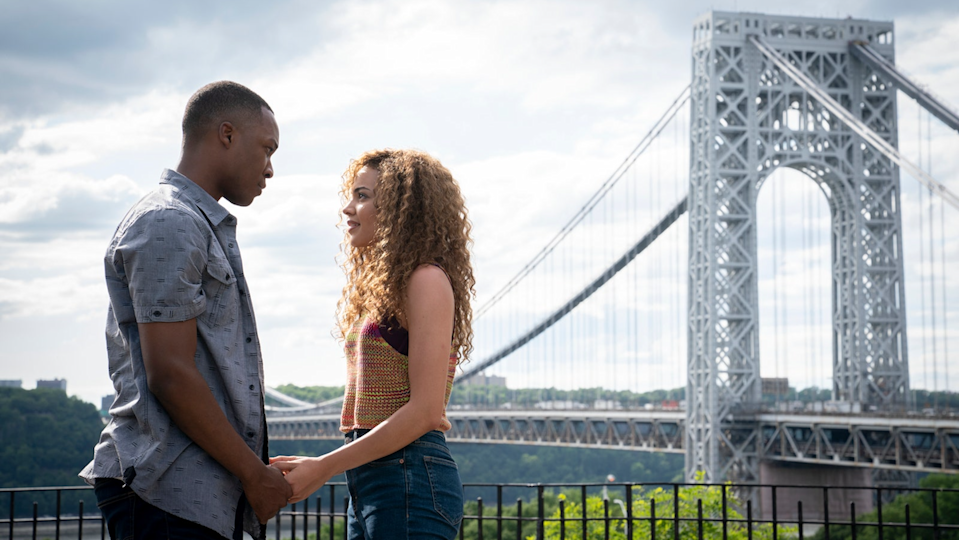 Benny and Nina hold hands before a sight of the George Washington Bridge.