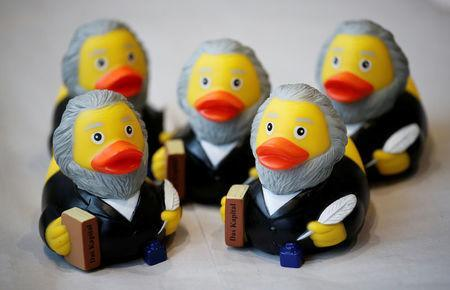 FILE PHOTO: Rubber ducks depicting German philosopher Karl Marx are for sale at the price of 5.90 euro (about 7.30 U.S. dollars) at a souvenir shop in his hometown in Trier, Germany, April 13, 2018. REUTERS/Wolfgang Rattay/File Photo