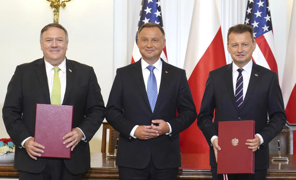 US Secretary of State Mike Pompeo, left, Poland's President Andrzej Duda, center, and Poland's Minister of Defence Mariusz Blaszczak pose for the media after signing the US-Poland Enhanced Defence Cooperation Agreement in the Presidential Palace in Warsaw, Poland, Saturday Aug. 15, 2020. Pompeo is on a five day visit to central Europe. (Janek Skarzynski/Pool via AP)