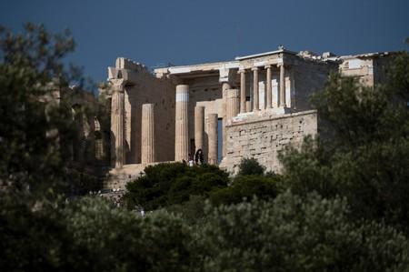 People make their way at the Propylea as they visit the archaeological site of the Acropolis hill in Athens