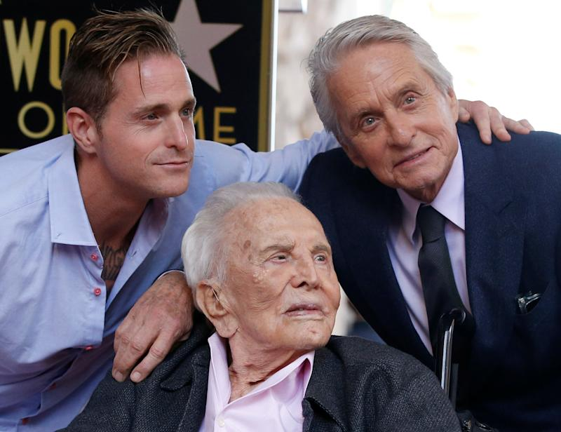 Actor Michael Douglas poses with his father Kirk Douglas and son Cameron Douglas during the unveiling of his star on the Hollywood Walk of Fame in Los Angeles, California, U.S., November 6, 2018. REUTERS/Mario Anzuoni