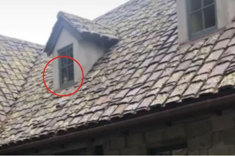 Woman Takes Video of Deserted Mansion, Daughter Spots Spooky Face Staring Through the Window