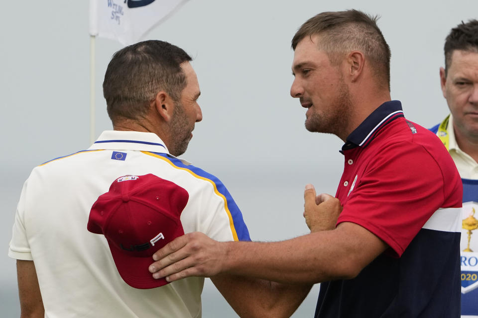 Team USA's Bryson DeChambeau shakes hands with Team Europe's Sergio Garcia after winning on the 16th hole during a Ryder Cup singles match at the Whistling Straits Golf Course Sunday, Sept. 26, 2021, in Sheboygan, Wis. (AP Photo/Jeff Roberson)