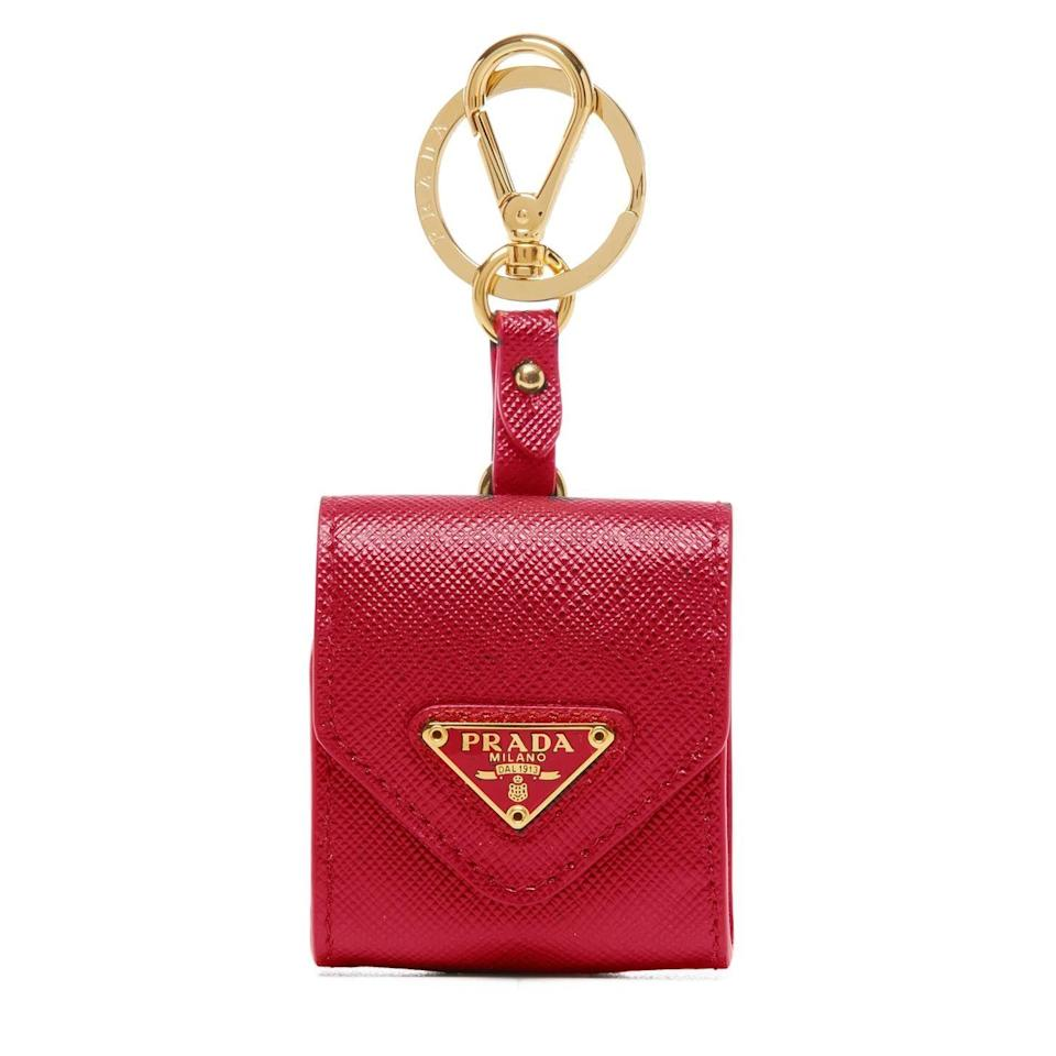 "<p><strong>Prada</strong></p><p>prada.com</p><p><strong>$380.00</strong></p><p><a href=""https://www.prada.com/us/en/products.saffiano_leather_airpod_case.1TL423_QHH_F068Z.html"" rel=""nofollow noopener"" target=""_blank"" data-ylk=""slk:Shop Now"" class=""link rapid-noclick-resp"">Shop Now</a></p><p>Attach this cute case in red and gold right to the exterior of your bag.</p>"