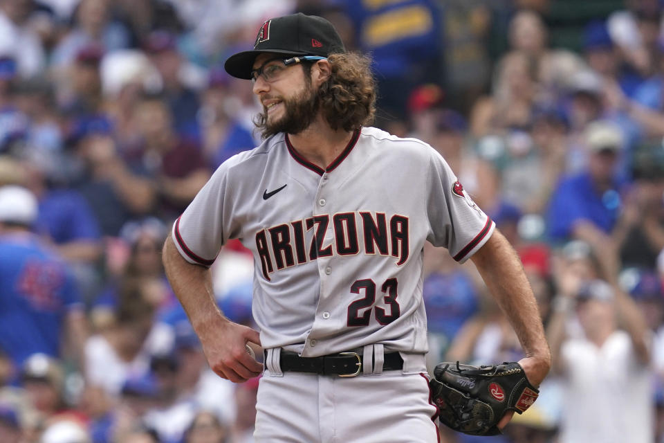 Arizona Diamondbacks starting pitcher Zac Gallen reacts after Chicago Cubs' Matt Duffy walked to first during the third inning of a baseball game in Chicago, Friday, July 23, 2021. (AP Photo/Nam Y. Huh)
