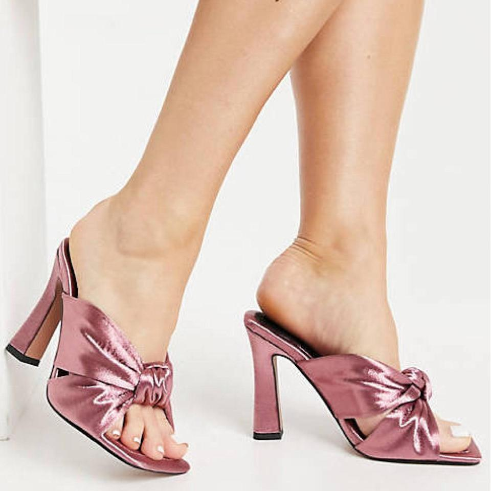 """These darling mauve slip-ons may feature a high heel, but it's wide and supportive enough to withstand hours-long nuptials. $46, ASOS. <a href=""""https://www.asos.com/us/asos-design/asos-design-wide-fit-norbiton-satin-twist-mules-in-mauve/prd/21788905?"""" rel=""""nofollow noopener"""" target=""""_blank"""" data-ylk=""""slk:Get it now!"""" class=""""link rapid-noclick-resp"""">Get it now!</a>"""