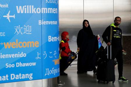 People exit immigration after arriving from Dubai on Emirates Flight 203 at John F. Kennedy International Airport in Queens, New York, U.S., January 28, 2017.  REUTERS/Andrew Kelly