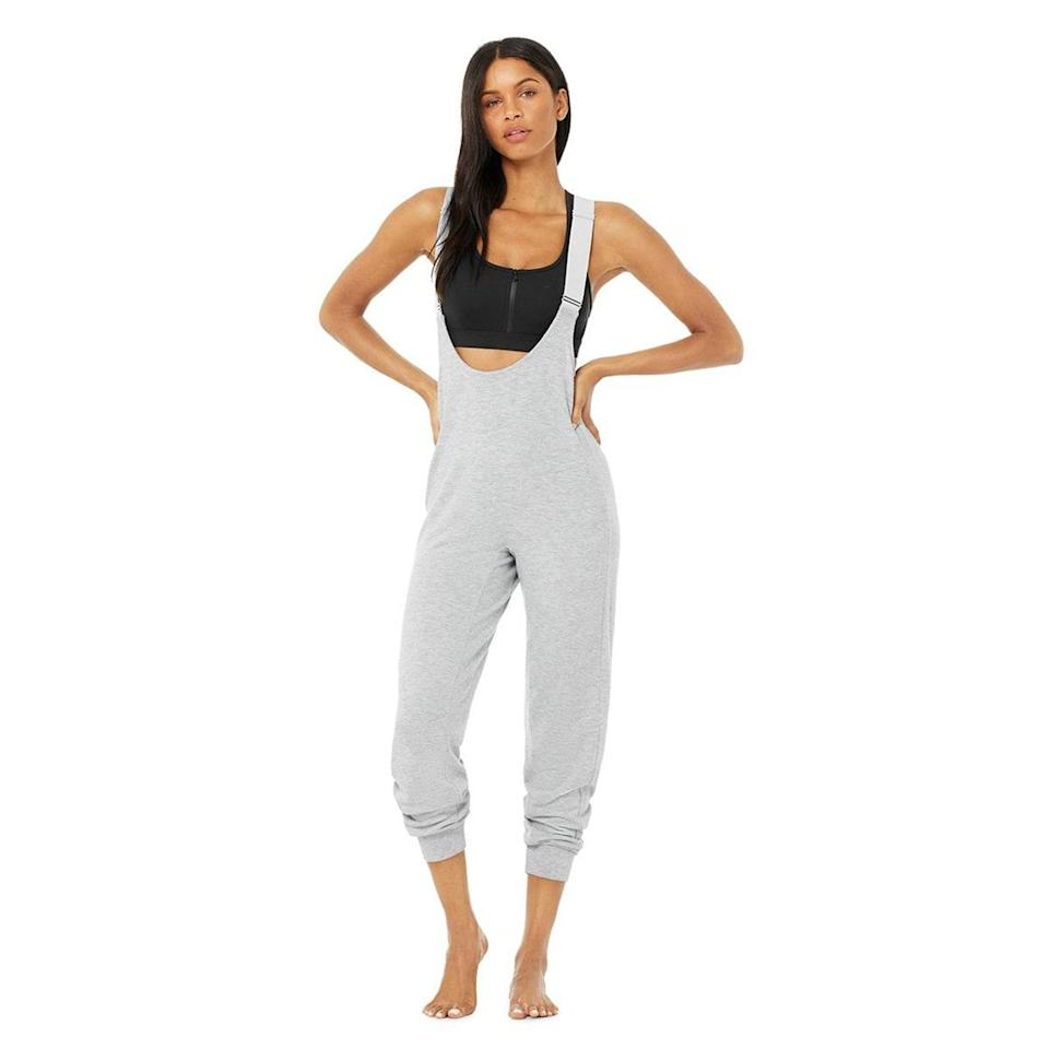"""Did somebody say """"hot toddies""""? Slip into the holiday mood with one of Alo's cozy jumpsuits, which will have you looking ready for the slopes even if you plan to stay posted with cookies and Netflix. $108, Alo. <a href=""""https://www.aloyoga.com/products/w8109r-layback-jumpsuit-dove-grey-heather"""" rel=""""nofollow noopener"""" target=""""_blank"""" data-ylk=""""slk:Get it now!"""" class=""""link rapid-noclick-resp"""">Get it now!</a>"""