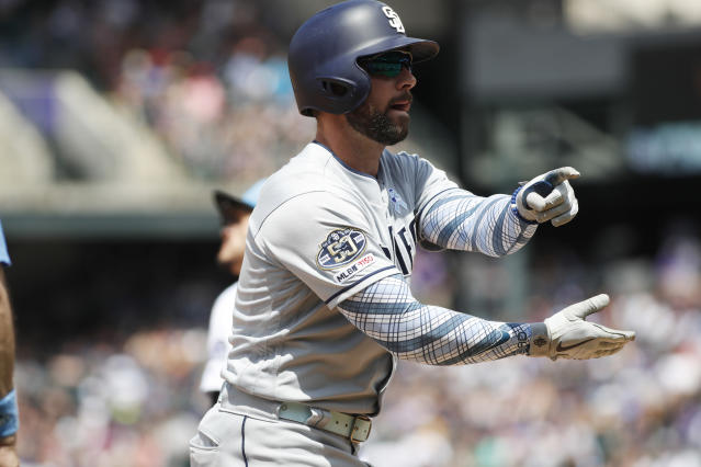 San Diego Padres' Greg Garcia gestures to the dugout after hitting a triple to drive in two runs off Colorado Rockies starting pitcher Peter Lambert in the third inning of a baseball game Sunday, June 16, 2019, in Denver. (AP Photo/David Zalubowski)