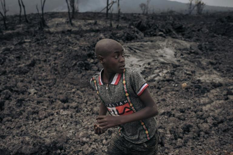 In the shadow of Nyiragongo: A child in the northern outskirts of Goma runs on a bed of solidified lava