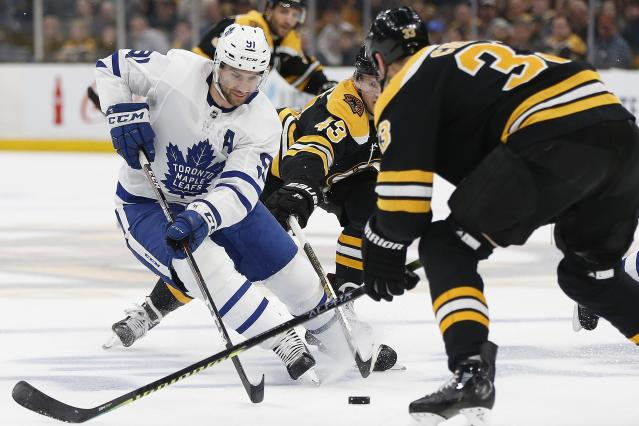 Boston Bruins' Danton Heinen (43) competes against Toronto Maple Leafs' John Tavares (91) for the puck during the first period in Game 5 of an NHL hockey first-round playoff series in Boston, Friday, April 19, 2019. (AP Photo/Michael Dwyer)