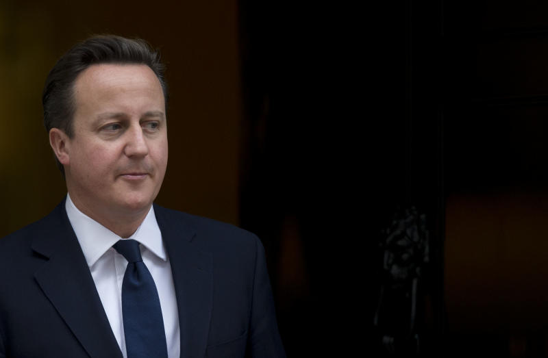 Britain's Prime Minister David Cameron walks out the front door of 10 Downing Street in London, to greet the Emir of Kuwait Sheikh Sabah al-Ahmad al-Sabah during his State Visit to the UK, Wednesday, Nov. 28, 2012. The judge who spent a year investigating the misdeeds of Britain's lively newspapers is giving Prime Minister David Cameron an early look at his recommendations for the regulation of the press. Officials say Cameron will get a copy of Lord Justice Brian Leveson's report Wednesday, a day before the public sees it, but Cameron is already being besieged with advice about how to respond to the still-secret recommendations. (AP Photo/Matt Dunham)