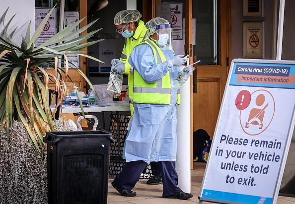 Medical staff at a pop-up COVID-19 testing clinic, perform tests on drivers in the Sydney suburb of Casula, Australia.