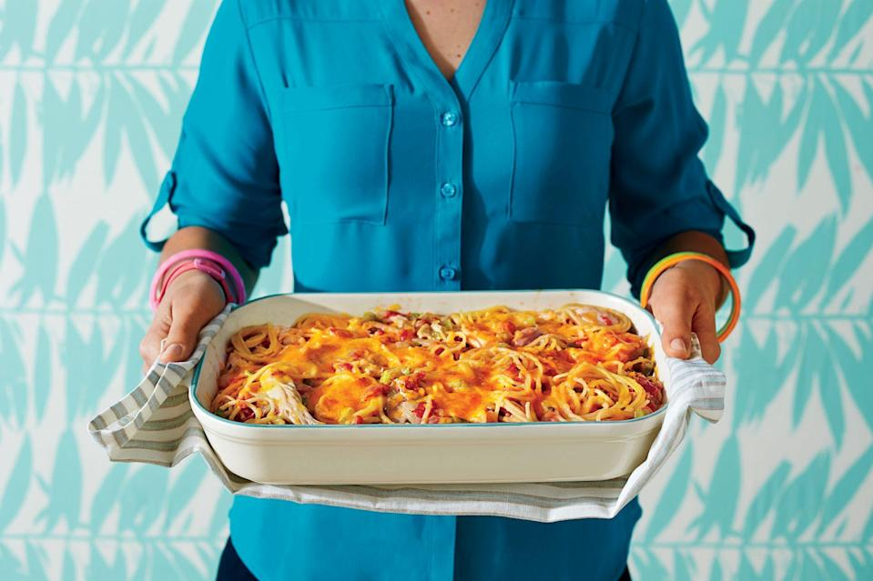 """<p><strong>Recipe: <a href=""""https://www.southernliving.com/recipes/chicken-spaghetti-casserole-recipe"""" rel=""""nofollow noopener"""" target=""""_blank"""" data-ylk=""""slk:Chicken Spaghetti Casserole"""" class=""""link rapid-noclick-resp"""">Chicken Spaghetti Casserole</a></strong></p> <p>You'll find chicken, butter, cheese, pasta, and a dash of hot sauce all on the ingredient list for this classic casserole.<strong><br></strong></p>"""