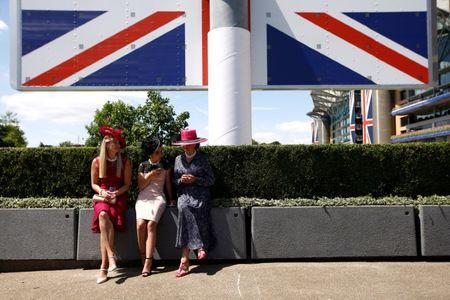 Horse Racing - Royal Ascot - Ascot Racecourse, Ascot, Britain - June 21, 2018 Racegoers take a seat outside before the start of the racing REUTERS/Peter Nicholls