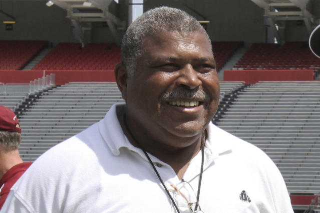 FILE - In this April 2, 2014, file photo, Houston Texans defensive coordinator Romeo Crennel smiles at South Carolina football pro day in Columbia, S.C. The late Bill Arnsparger and Houston associate head coach Romeo Crennel have won the Paul Dr. Z Zimmerman award from the Professional Football Writers of America, started by the PFWA in 2014 to recognize lifetime achievement among assistant coaches. (AP Photo/Mary Ann Chastain, File)