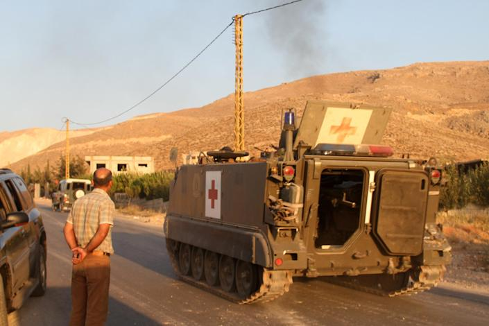 A Lebanese army medical evacuation APC drives to the entrance of the town of Arsal in the Bekaa valley by the Syrian border on August 2, 2014 (AFP Photo/)