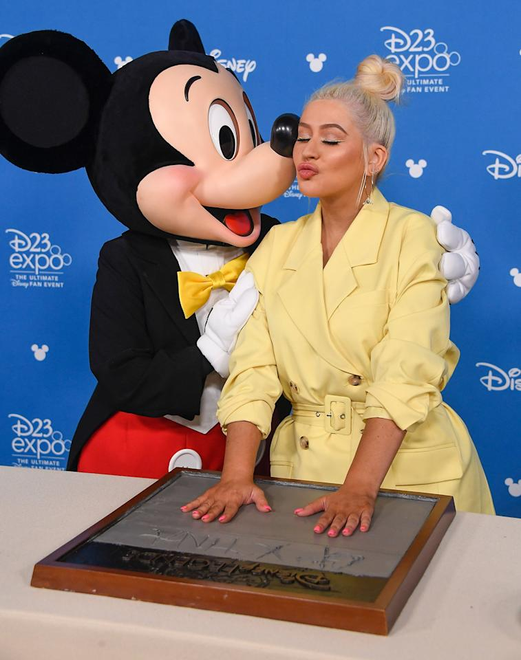 Christina Aguilera and Mickey Mouse attend the D23 Disney Legends event on Friday in Anaheim, California.