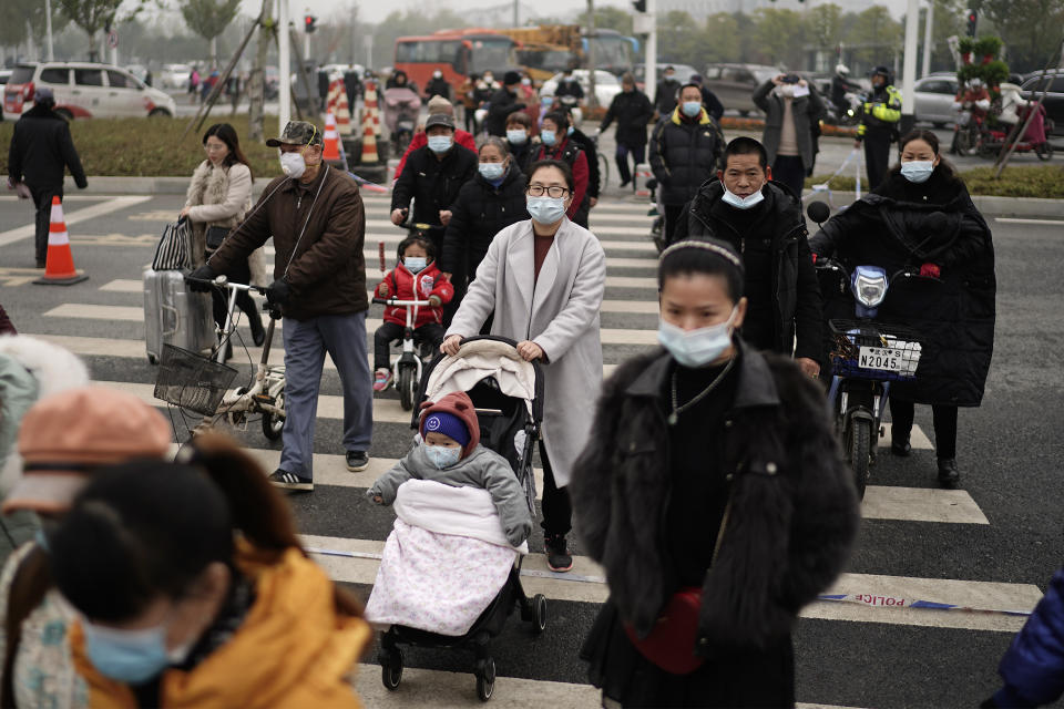 WUHAN, CHINA - DECEMBER 11: (CHINA OUT)Residents wear the mask during a new Wanda Plaza opening ceremony on December 11, 2020 in Wuhan, Hubei Province,China. Wuhan With no recorded cases of community transmissions since May, life for residents is gradually returning to normal.(Photo by Getty Images)