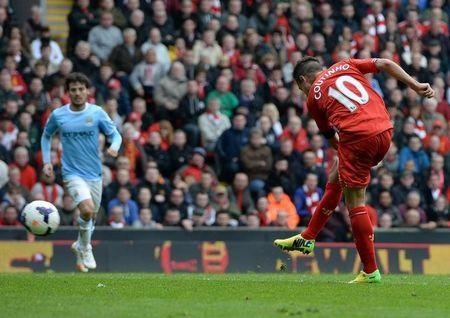 FILE PHOTO - Liverpool's Philippe Courtinho (R) shoots to score against Manchester City during their English Premier League soccer match at Anfield in Liverpool, northern England April 13, 2014. REUTERS/Nigel Roddis