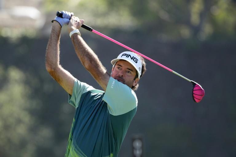 A spectacular hole-out for birdie from a greenside bunker at the 14th gave Bubba Watson sole possession of the lead for good and an emotional third Genesis Open title