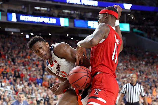 De'Andre Hunter #12 of the Virginia Cavaliers and Tariq Owens #11 of the Texas Tech Red Raiders battle for the ball in the second half during the 2019 NCAA men's Final Four National Championship game at U.S. Bank Stadium on April 08, 2019 in Minneapolis, Minnesota. (Photo by Streeter Lecka/Getty Images)